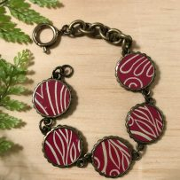 Vintage Tin Bracelet Link Style with Resin Overlay -Antique Brass with Red Line Motif