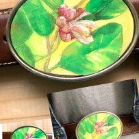 Vintage Tin Belt Buckle Key Lime Blossom under Resin