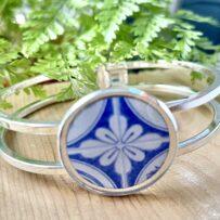 B. Vintage Tin Hinged Cuff Bracelet Under Resin-Stylized Blue & White Floral