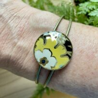 Vintage Tin Cuff Bracelet Under Resin – Antique Brass with Stylized Yellow Flower